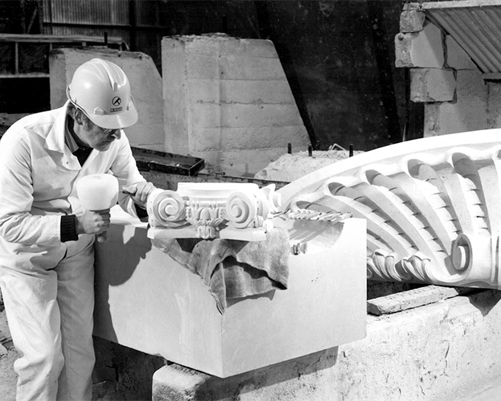 John Selman working portico stones
