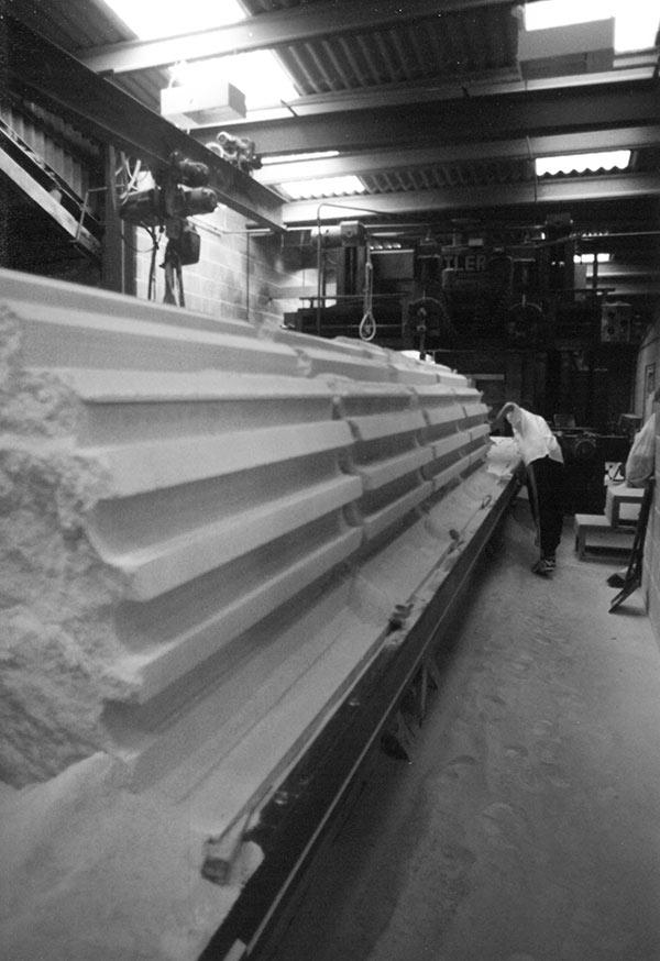 Planer working Portland limestone fluted columns