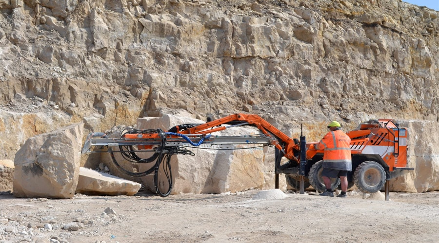 Splitting Portland stone block by drill rig